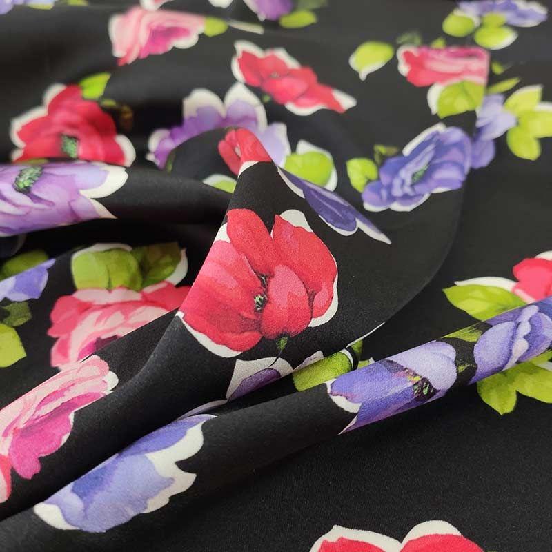 tessuto elasticizzato a fantasia fiori con fondo nero