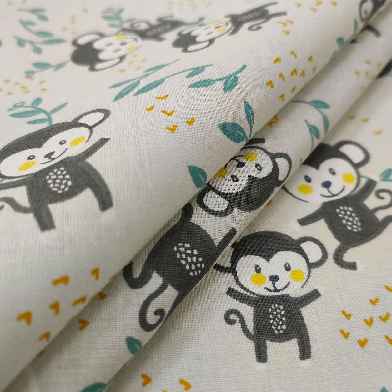 Tessuto di Cotone Scimmiette Felici