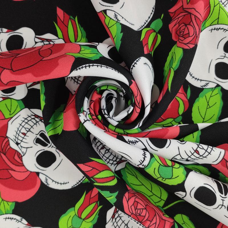 Tessuto Teschi con Rose Rosse