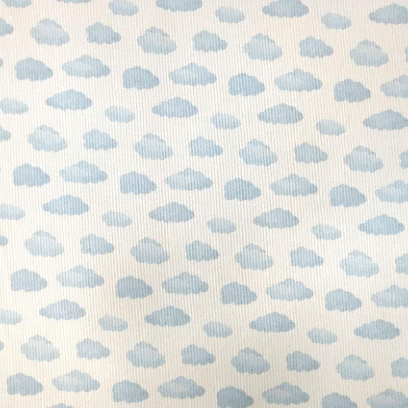 Tessuto Piquet di Cotone Fantasia Nuvolette Azzurre