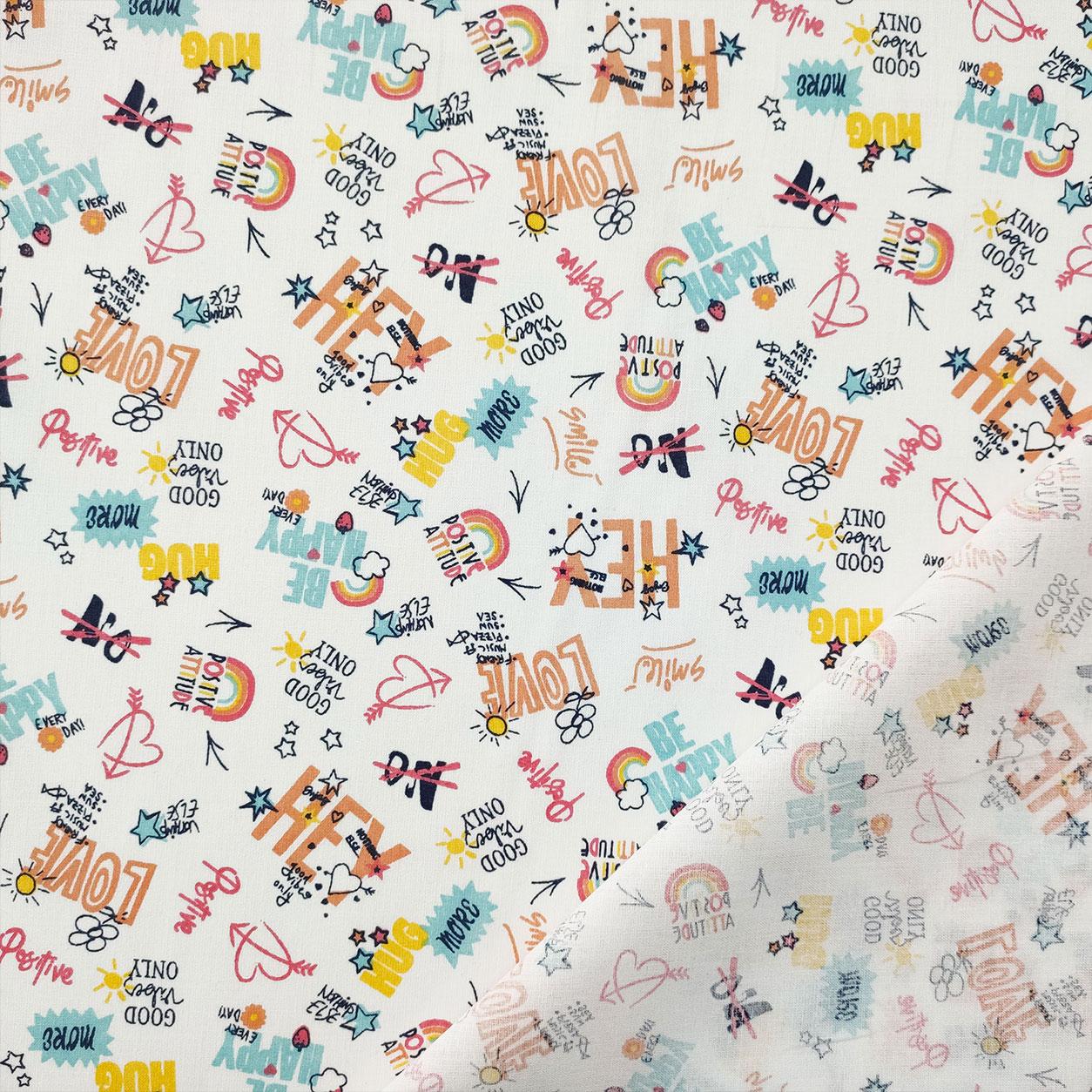 Tessuto di Cotone Scritte Colorate