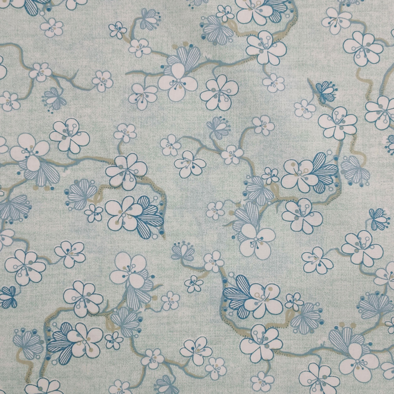 Tessuto Cotone Fantasia Fiori e Rami Sfondo Azzurro