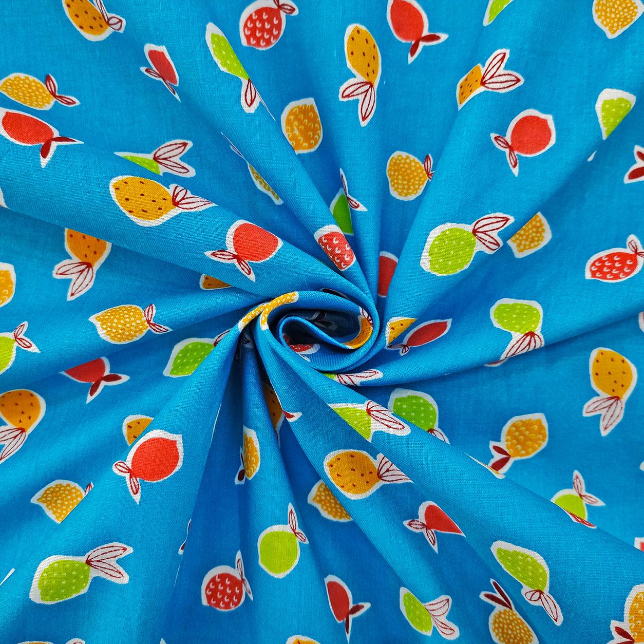Tessuto di Cotone Frutti su Sfondo Azzurro