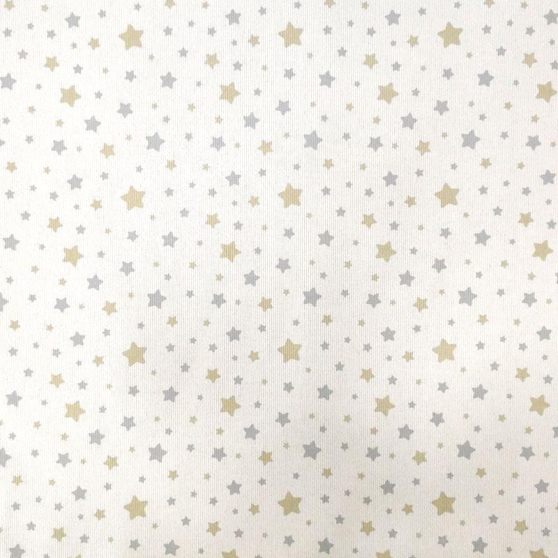 Tessuto Piquet di Cotone Fantasia Stelline Beige